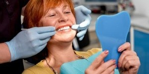 smiling-at-dentist-300x200-min